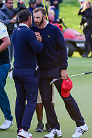 Brooks Koepka (USA) and Dustin Johnson (USA) chest bump in celebration of winning their match on 16 during round 3 Four-Ball of the 2017 President's Cup, Liberty National Golf Club, Jersey City, New Jersey, USA. 9/30/2017.<br /> Picture: Golffile | Ken Murray<br /> <br /> All photo usage must carry mandatory copyright credit (&copy; Golffile | Ken Murray)