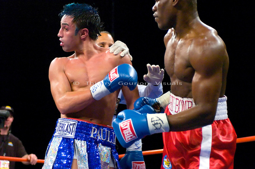 Edner Cherry on the attack against  Paulie Malignaggi (white/blue) during their 10 rounds lightweight fight at the Hammerstein ballroom in NYC on 02.17.07.<br />