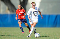 2 October 2011:  FIU's Johanna Volz (5) moves the ball upfield while being pursued by South Alabama's.Kristyn Thacker (5) in the second half as the FIU Golden Panthers defeated the University of South Alabama Jaguars, 2-0, at University Park Stadium in Miami, Florida.