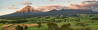 Sunrise over Taranaki, Mount Egmont and farmland below, Egmont National Park, Taranaki Region, North Island, New Zealand, NZ