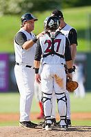 Kannapolis Intimidators manager Tommy Thompson #39 has a chat on the mound with catcher Kevin Dubler #27 and pitcher Matt Heidenreich #51 during the game against the Lakewood BlueClaws at Fieldcrest Cannon Stadium on July 17, 2011 in Kannapolis, North Carolina.  The BlueClaws defeated the Intimidators 4-3.   (Brian Westerholt / Four Seam Images)