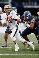 Annapolis, MD - December 28, 2015:     Pittsburgh Panthers quarterback Nathan Peterman (4) gets sacked by Navy Midshipmen defensive end Jarvis Polu (67) during the Military Bowl game between Pitt vs Navy at Navy-Marine Corps Memorial Stadium in Annapolis, MD. (Photo by Elliott Brown/Media Images International)