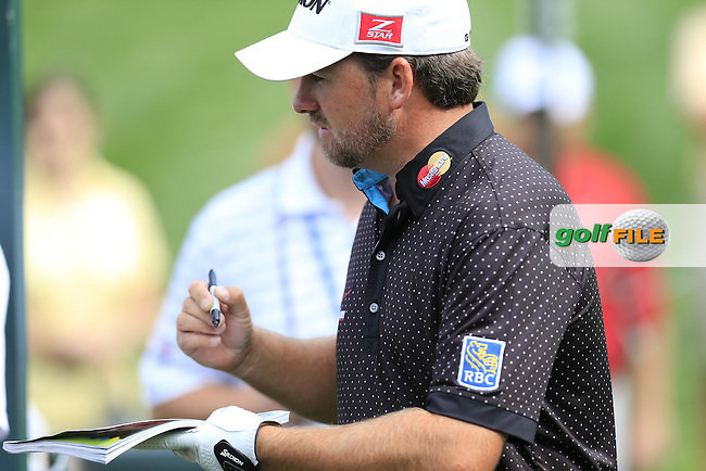 Graeme McDowell (NIR) signs autographs during Tuesday's Practice Day of the 95th US PGA Championship 2013 held at Oak Hills Country Club, Rochester, New York.<br /> 6th August 2013.<br /> Picture: Eoin Clarke www.golffile.ie