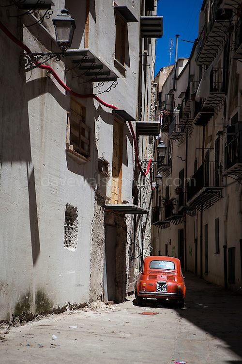 A red Fiat 500 Cinquecento parked in a backstreet, Palermo, Italy. (c) 2013 Dave Walsh