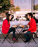 USA, California, Los Angeles, couple having breakfast at an outdoor table at Joan's On Third Cafe.