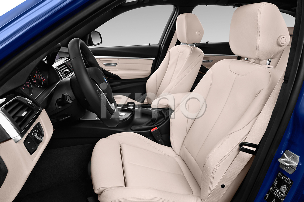 Front seat view of a 2017 BMW 3 Series Touring 330i xDrive 5 Door Wagon front seat car photos