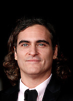 "L'attore, cantante e musicista statunitense Joaquin Phoenix posa sul red carpet per la presentazione del film ""Her"" all'ottava edizione del Festival Internazionale del Film di Roma, 10 novembre 2013.<br />