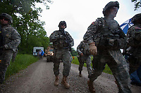 Brigadier General Lawrence E. Dudney Jr. (right) walks as members of the Georgia Army National Guard's 48th Brigade, 148th Brigade Support Battalion, train in an attack and medical evacuation scenario during a media visit day at Camp Atterbury, Indiana on Wednesday, June 3, 2009. Dudney is the commanding general of Task Force Phoenix. The brigade's upcoming overseas mission is to train the Afghan National Army and Police forces.