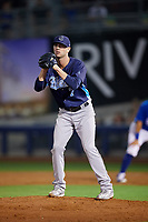 Corpus Christi Hooks relief pitcher Jacob Dorris (7) gets ready to deliver a pitch during a game against the Tulsa Drillers on June 3, 2017 at ONEOK Field in Tulsa, Oklahoma.  Corpus Christi defeated Tulsa 5-3.  (Mike Janes/Four Seam Images)