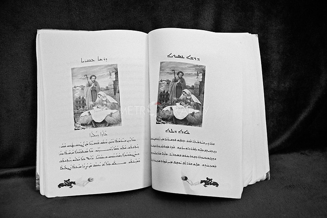25..3.2015 Kirkuk,Iraq: Marta's school book written in Syriac language (a language which is used by Christians in the Middle East).