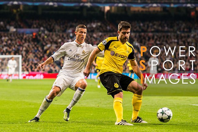 Sokratis Papastathopoulos (r) of Borussia Dortmund competes for the ball with Cristiano Ronaldo of Real Madrid during the 2016-17 UEFA Champions League match between Real Madrid and Borussia Dortmund at the Santiago Bernabeu Stadium on 07 December 2016 in Madrid, Spain. Photo by Diego Gonzalez Souto / Power Sport Images