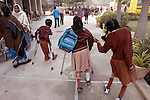 NEW DELHI, INDIA, FEBRUARY 19, 2004 : Schoolchildren, many of them polio victims, arrive in the morning at the Akshay Pratishtan School in New delhi, on February 19, 2004. The Askshay Pratishtan School is a private institution providing education and rehabilitation in an integrated school environment. Physically handicapped children, most of them polio victims, live and learn alongside other children. India is one of the last remaining polio endemic country in the world and has been involved in an extensive immunization program to eradicate the deadly virus. (Photo Jean-Marc Giboux)