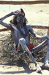 A Shaiva Sadhu lying on a bed of thorns.It was estimated that over 100,000 Sadhus and holy men attended the Maha Kumbha Mela in 1989.Maha Kumbha Mela is held every twelve years at Prayag (Allahabad) in Uttar Pradesh in India.
