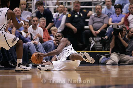Salt Lake City - Utah Jazz forward Paul Millsap (24) grabs a loose ball and looks to pass to teammate Utah Jazz guard Dee Brown (11, left). Utah Jazz vs. Golden State Warriors, NBA Playoff basketball, Game 5, at EnergySolutions Arena.