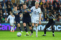 Mike-Steven Bähre of Barnsley battles with Sam Surridge of Swansea City during the Sky Bet Championship match between Swansea City and Barnsley at the Liberty Stadium in Swansea, Wales, UK. Sunday 29 December 2019