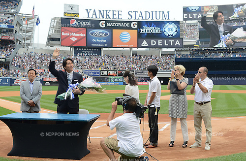 Hideki Matsui,<br /> JULY 28, 2013 - MLB :<br /> Hideki Matsui waves to fans as his father Masao, mother Saeko, brother, New York Yankees general manager Brian Cashman and assistant general manager Jean Afterman look on during his official retirement ceremony before the Major League Baseball game against the Tampa Bay Rays at Yankee Stadium in The Bronx, New York, United States. (Photo by AFLO)