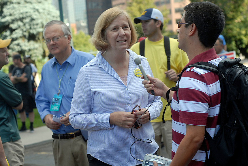 24 Aug 08: Anti-war activist Cindy Sheehan speaks to a reporter prior to giving a speech on the steps of the Colorado State Capitol Building. On the day before the Democratic National Convention is scheduled to begin about 1,500 people participated in the ReCreate 68 rally, which included a march from the Colorado state capitol building to the Pepsi Center.