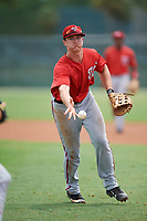 GCL Nationals first baseman Jackson Cramer (25) flips the ball to the pitcher covering first during the second game of a doubleheader against the GCL Marlins on July 23, 2017 at Roger Dean Stadium Complex in Jupiter, Florida.  GCL Nationals defeated the GCL Marlins 1-0.  (Mike Janes/Four Seam Images)