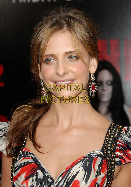 "SARAH MICHELLE GELLAR.attends The Columbia Pictures World Premiere of .""The Grudge 2"" held at Knott's Scary Farm in Buena Park, .California, USA, October 8th 2007..portrait headshot black and white red patterned print dress long gold studs earrings.Ref: DVS.www.capitalpictures.com.sales@capitalpictures.com.©Debbie VanStory/Capital Pictures"