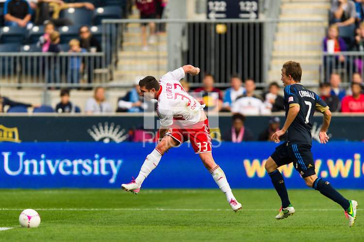 Kenny Cooper (33) of the New York Red Bulls shoots and scores during the second half against the  of the Philadelphia Union. The New York Red Bulls defeated the Philadelphia Union 3-0 during a Major League Soccer (MLS) match at PPL Park in Chester, PA, on October 27, 2012.