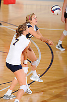 24 September 2010:  FIU's Chanel Araujo (13) saves the ball in the third set as the FIU Golden Panthers defeated the University of Denver Pioneers, 3-0 (29-27, 25-16, 25-20), at U.S Century Bank Arena in Miami, Florida.