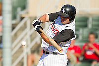 Dan Black #40 of the Kannapolis Intimidators makes contact with the baseball during the game against the Lakewood BlueClaws at Fieldcrest Cannon Stadium on July 17, 2011 in Kannapolis, North Carolina.  The BlueClaws defeated the Intimidators 4-3.   (Brian Westerholt / Four Seam Images)