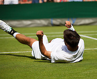 29-06-13, England, London,  AELTC, Wimbledon, Tennis, Wimbledon 2013, Day six, Igor Sijsling (NED) falls to the ground and stops the match a few games later<br /> <br /> <br /> <br /> Photo: Henk Koster