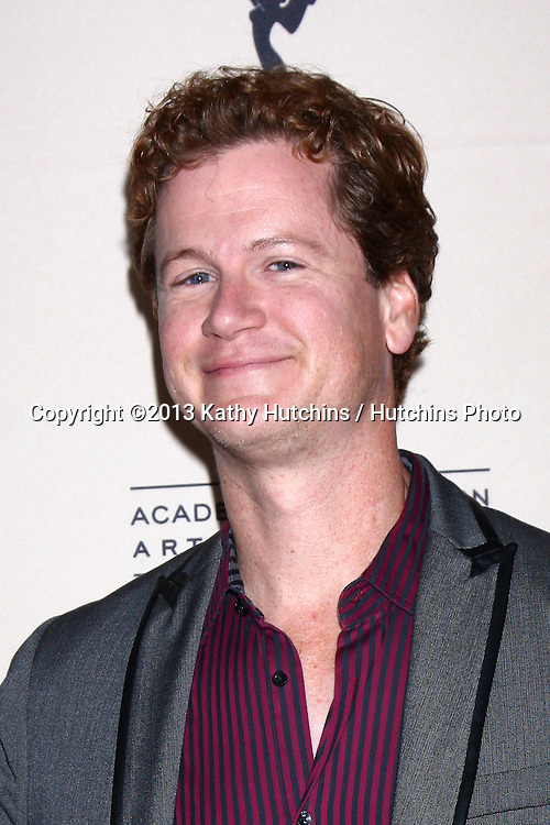 LOS ANGELES - JUN 13:  Jonathan Mangum arrives at the Daytime Emmy Nominees Reception presented by ATAS at the Montage Beverly Hills on June 13, 2013 in Beverly Hills, CA