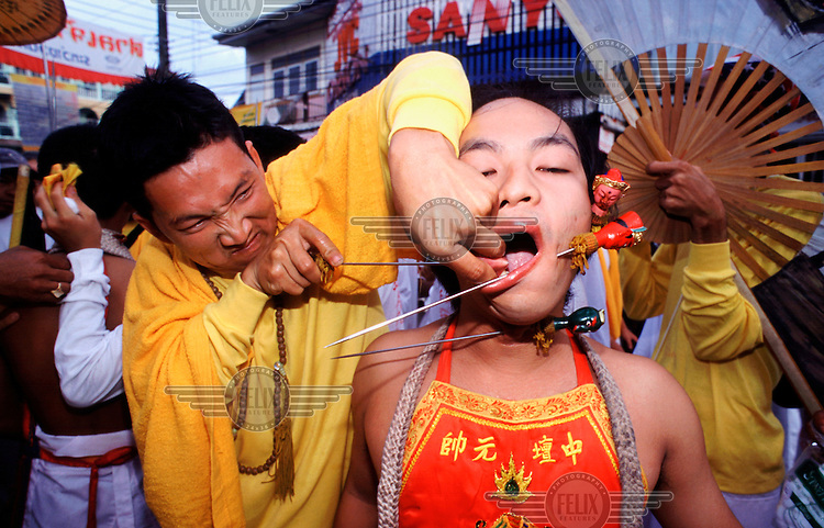 The Vegetarian Festival in Phuket. Once a year the descendents of Chinese immigrants engage in a gory festival of self mutilation with an astonishing variety of implements, and abstain from eating meat for nine days.