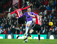 Bolton Wanderers' Gary Madine battles with Brentford's Romaine Sawyers and Chris Mepham<br /> <br /> Photographer Alex Dodd/CameraSport<br /> <br /> The EFL Sky Bet Championship - Brentford v Bolton Wanderers - Saturday 13th January 2018 - Griffin Park - Brentford<br /> <br /> World Copyright &copy; 2018 CameraSport. All rights reserved. 43 Linden Ave. Countesthorpe. Leicester. England. LE8 5PG - Tel: +44 (0) 116 277 4147 - admin@camerasport.com - www.camerasport.com
