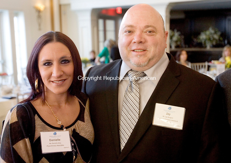 PROSPECT CT. 30 January 2014-013014SV08-From left, Danielle Gray of Physiotherapy Associates and Jay Sargent of TC's Pawn Company Jewelry &amp; Electronics Exchange PC attend the 2014 Harold Webster Smith Awards in Prospect Thursday. The Awards established by Waterbury Regional Chamber's Small Business Council recognize companies that have shown achievement and excellence in small business. TC&rsquo;s was the Small Business of the year. <br /> Steven Valenti Republican-American