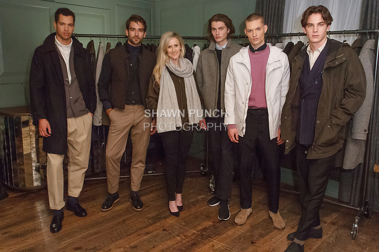 Fashion designers Annie Campbell poses with models during her Exley NB Fall Winter 2017 collection fashion presentation, at The Soho House in New York City on March 7, 2017.