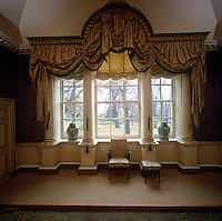 One of Nostell Priory's signature columned windows is framed with a massive pelmet supporting an ornate festoon blind