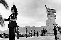 """Albania. Tirana. National Martyrs Cemetery. The Orchestra Frymore is the only Albanian military brass band. A military band is a group of personnel that performs musical duties for military functions or official events. A typical military band consists mostly of wind and percussion instruments. The conductor of the band bears commonly the title of Bandmaster or Director of Music. Fatmir Foçi (R) was the band's conductor for the last 35 years. He now supervises the work of his young colleague (L). The band is playing on National Day at the National Martyrs Cemetery of Albania which is the largest cemetery in Albania, located on a hill overlooking Tirana. The monument is a giant scuplture called """" Mother Albania"""". Tirana is the capital and largest city of Republic of Albania. 29.11.1998 © 1998 Didier Ruef"""