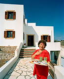 GREECE, Patmos, Kambos, Dodecanese Island, Irini Kaneli welcomes guests to her home