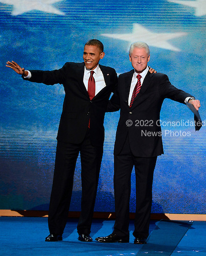 Former United States President Bill Clinton hugs U.S. President Barack Obama after delivering remarks at the 2012 Democratic National Convention in Charlotte, North Carolina on Wednesday, September 5, 2012.  .Credit: Ron Sachs / CNP.(RESTRICTION: NO New York or New Jersey Newspapers or newspapers within a 75 mile radius of New York City)
