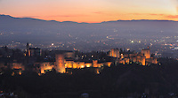 The Alhambra Palace illuminated at night, Granada, Andalusia, Southern Spain. The Alhambra was begun in the 11th century as a castle, and in the 13th and 14th centuries served as the royal palace of the Nasrid sultans. The huge complex contains the Alcazaba, Nasrid palaces, gardens and Generalife. Picture by Manuel Cohen
