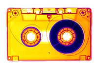 X-ray of a audio cassette.  The compact audio cassette is a cassette-based version of the older reel-to-reel tape format.  This format recorded audio (sound) on magnetic tape.  This format was replaced by the compact disc.
