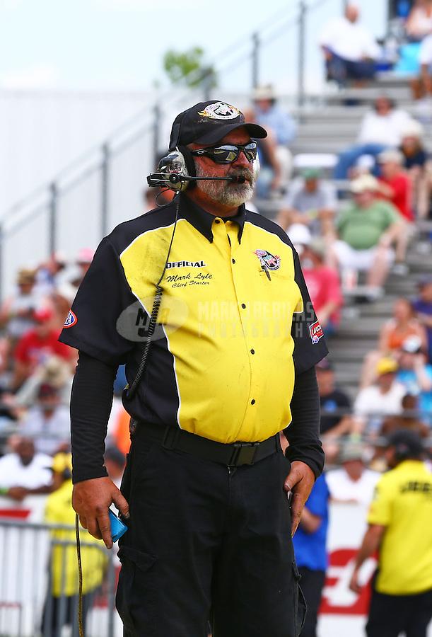 Jun. 2, 2013; Englishtown, NJ, USA: NHRA official starter Mark Lyle during the Summer Nationals at Raceway Park. Mandatory Credit: Mark J. Rebilas-