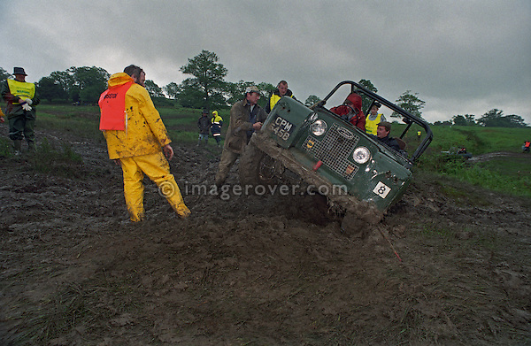 Marshall at the1993 A.R.C. National Rally overseeing the recovery of a stuck Land Rover Series 2a off-road racer. The Association of Rover Clubs (A.R.C., since 2006 the Association of Land Rover Clubs ALRC) National Rally is the biggest annual motor sport oriented Land Rover event and was hosted 1993 by the Midland Rover Owners Club at Eastnor Castle in Herefordshire. --- No releases available. Automotive trademarks are the property of the trademark holder, authorization may be needed for some uses.