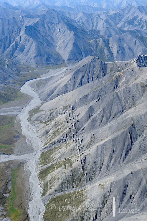 Jagged mountains and dry riverbeds mark an aerial summer view of the northern portion of the Brooks Range in Alaska's Arctic National Wildlife Refuge.