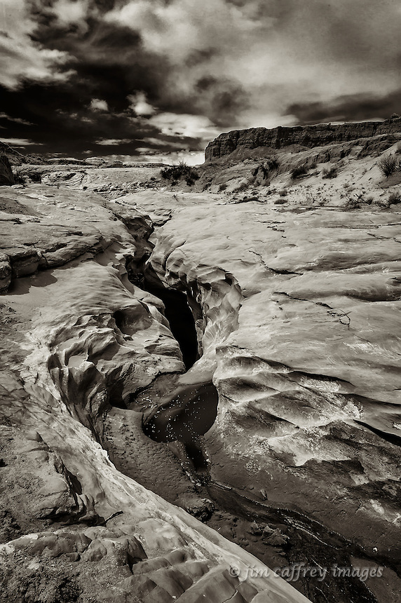 A sepia toned image of the place where the stream enters the Water Caves on the Hopi Reservation in northeastern Arizona.