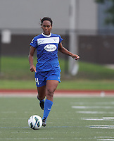 Boston Breakers defender Kia McNeill (14) brings the ball forward.  In a National Women's Soccer League (NWSL) match, Boston Breakers (blue) tied Western New York Flash (white), 2-2, at Dilboy Stadium on August 3, 2013.