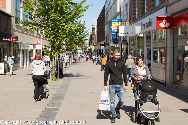 People shopping in pedestrianised street in Regent Street, town centre of Swindon, Wiltshire, England, UK