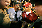 Florida State head coach Bobby Bowden greets Penn State head coach Joe Paterno after the game when the 3rd ranked Penn State Nittany Lions defeated the 22nd ranked Florida State Seminoles 26-23 in a triple overtime game between college football's winningest coach Bobby Bowden (359) and Joe Paterno (354) who got one game closer at the FedEx Orange Bowl January 3, 2006 in Miami, Florida.    (Mark Wallheiser/TallahasseeStock.com)