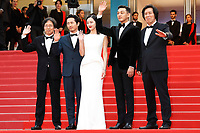 "(L-R) Executive producer Jun-dong Lee, actor Steven Yeun, actress Jong-seo Jeon, actor Ah-in Yoo and director Chang-dong Lee at the ""Burning"" premiere during the 71st Cannes Film Festival at the Palais des Festivals on May 16, 2018 in Cannes, France. Credit: John Rasimus / Media Punch ***FRANCE, SWEDEN, NORWAY, DENARK, FINLAND, USA, CZECH REPUBLIC, SOUTH AMERICA ONLY***"