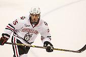 Kevin Roy (NU - 15) - The visiting University of Vermont Catamounts defeated the Northeastern University Huskies 6-2 on Saturday, October 11, 2014, at Matthews Arena in Boston, Massachusetts.