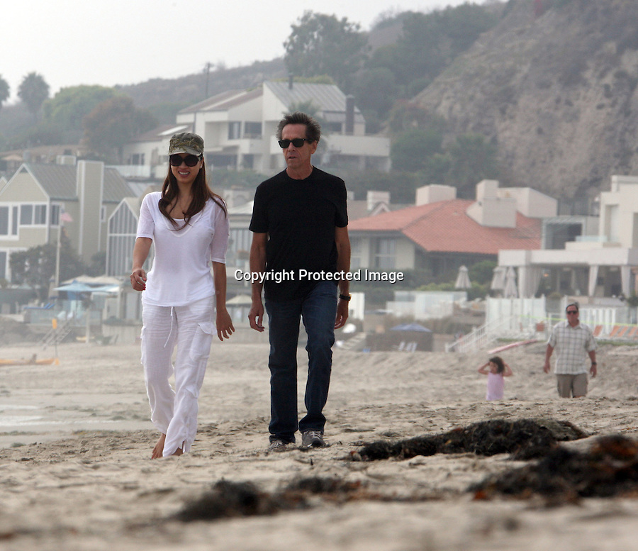 .September 5th 2010 exclusive ..Brian Grazer walking on the beach in Malibu with his wife. You can see actor Jon Favreau walking in the background with his kid...AbilityFilms@yahoo.com.805-427-3519.www.AbilityFilms.com