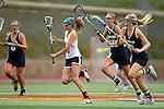 San Diego, CA 04/19/10 - Kacey McKinnon (Torrey Pines #5), Caitlin Solomon (La Costa Canyon #8) and Caitlin Zirpolo (La Costa Canyon #10) in action during the Torrey Pines-La Costa Canyon Girls Lacrosse game at Torrey Pines.