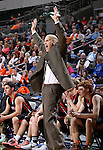 SIOUX FALLS, SD - MARCH 19: Head coach Tim Buddenhagen from Huron shouts animated instructions to his team in the first half of their quarterfinal game against Washington, Thursday afternoon during the Boys State AA Basketball Tournament at the Denny Sanford Premire Center in Sioux Falls, SD. (Photo by Dave Eggen/Inertia)